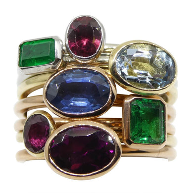 The Jackie Stackie! 7 stacking rings: Emerald, Sapphire, Ruby Garnet, Aquamarine Seven Ring Stacker Set in 10kt Gold - Skyjems Wholesale Gemstones