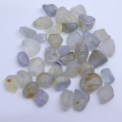 Rough Sapphire 50 cts <<MEASUREMENTS>>mm <<SHAPE>> Grey / Grey Blue / Light Yellow / White  $200