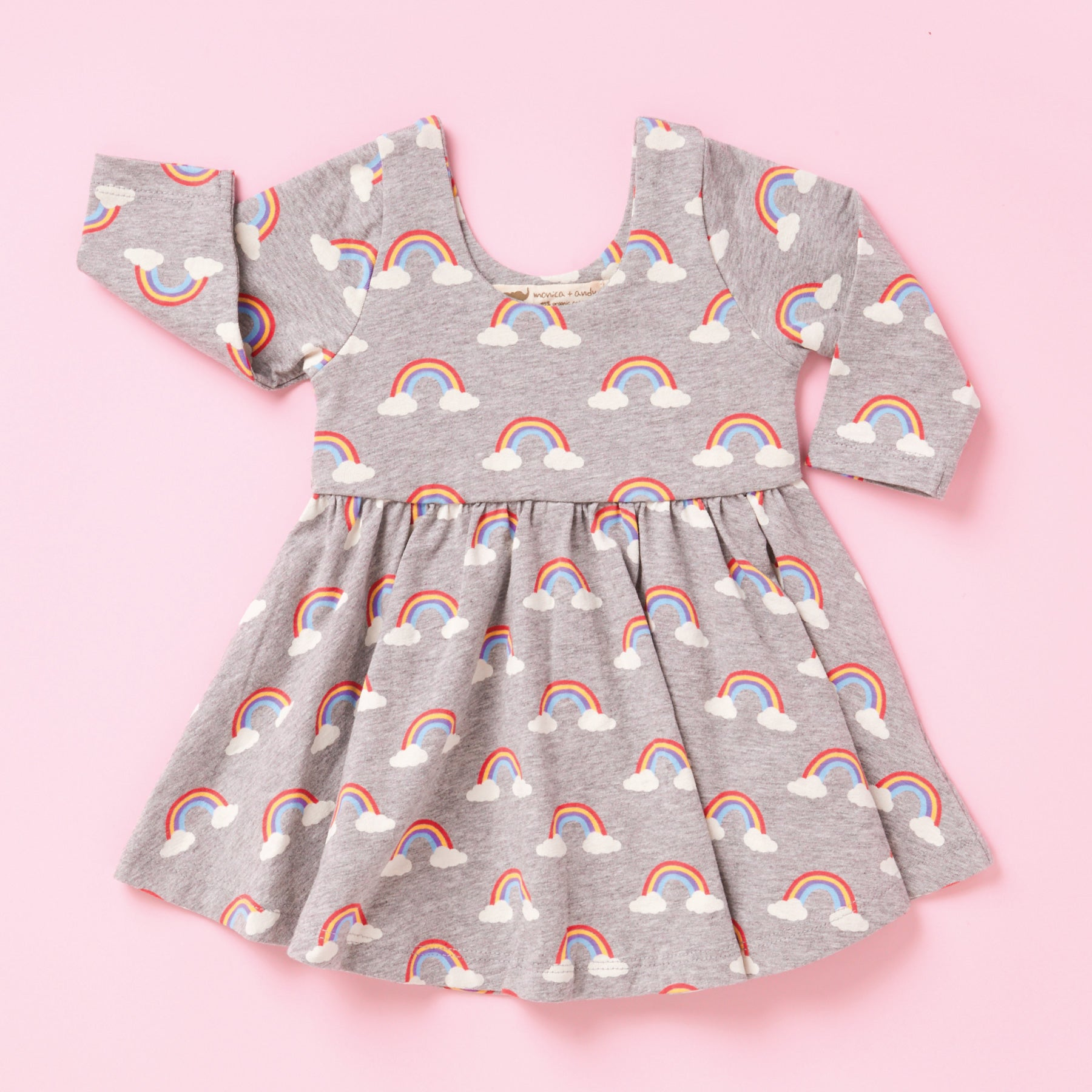 dress with rainbow skies print on pink background
