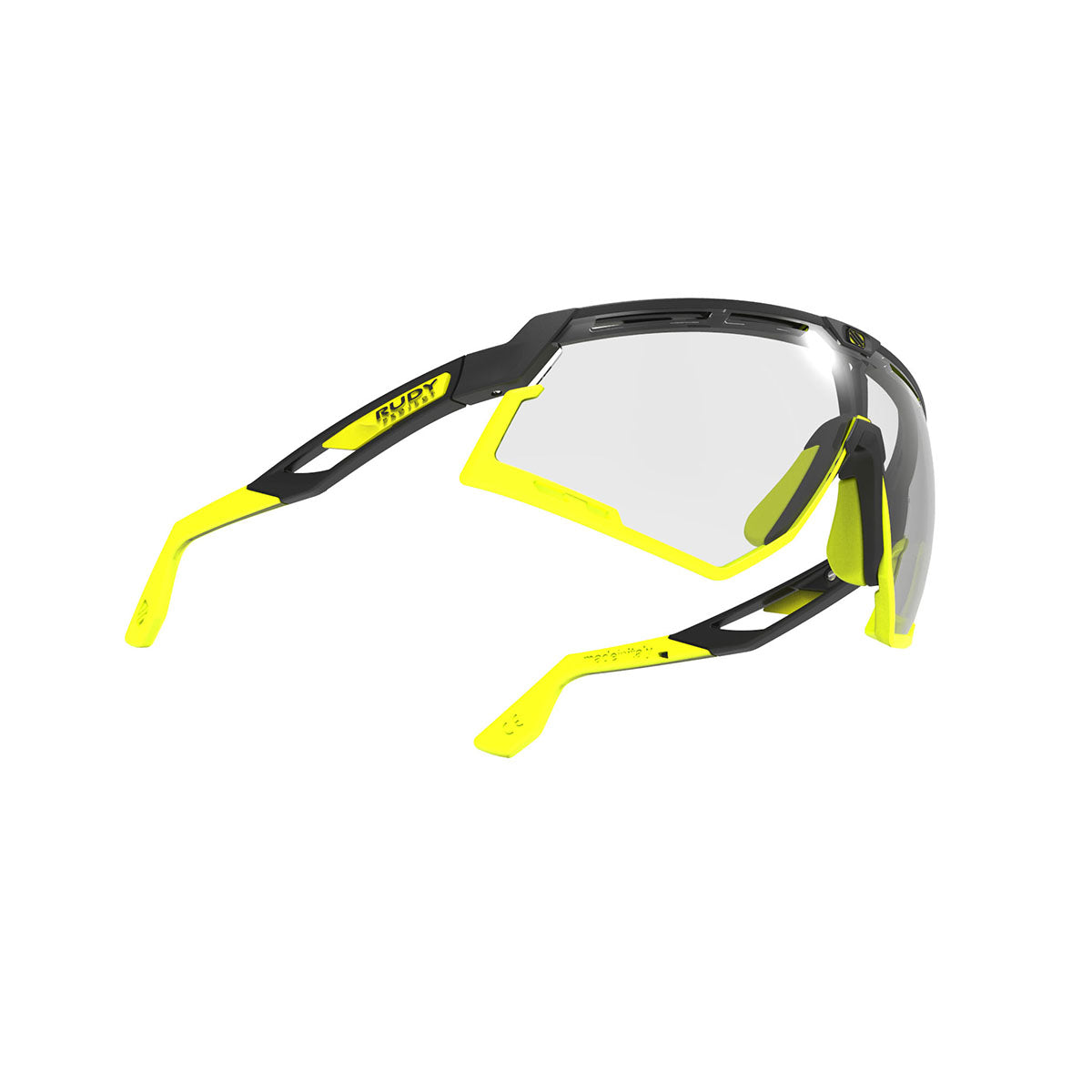 Rudy Project - Defender - frame color: Matte Black - lens color: ImpactX-2 Photochromic Clear to Laser Black - Bumper Color: Yelow Fluo - photo angle: Bottom Front Angle Variant Hover Image