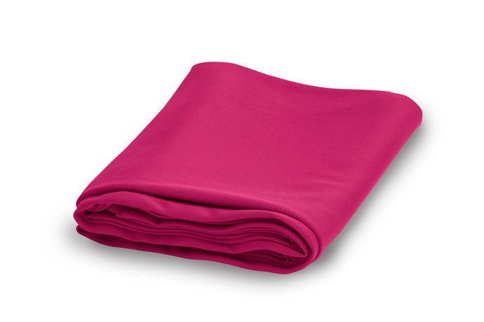 Folded Extreme Ultralight Sports and Travel fast-drying towel in fuchsia.