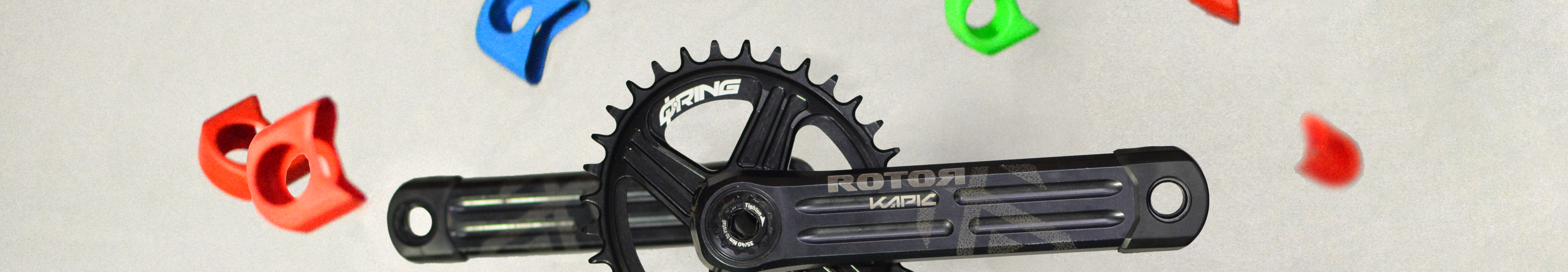 ROTOR KAPIC Cranks with colorful boots in red, orange, yellow, blue, and green