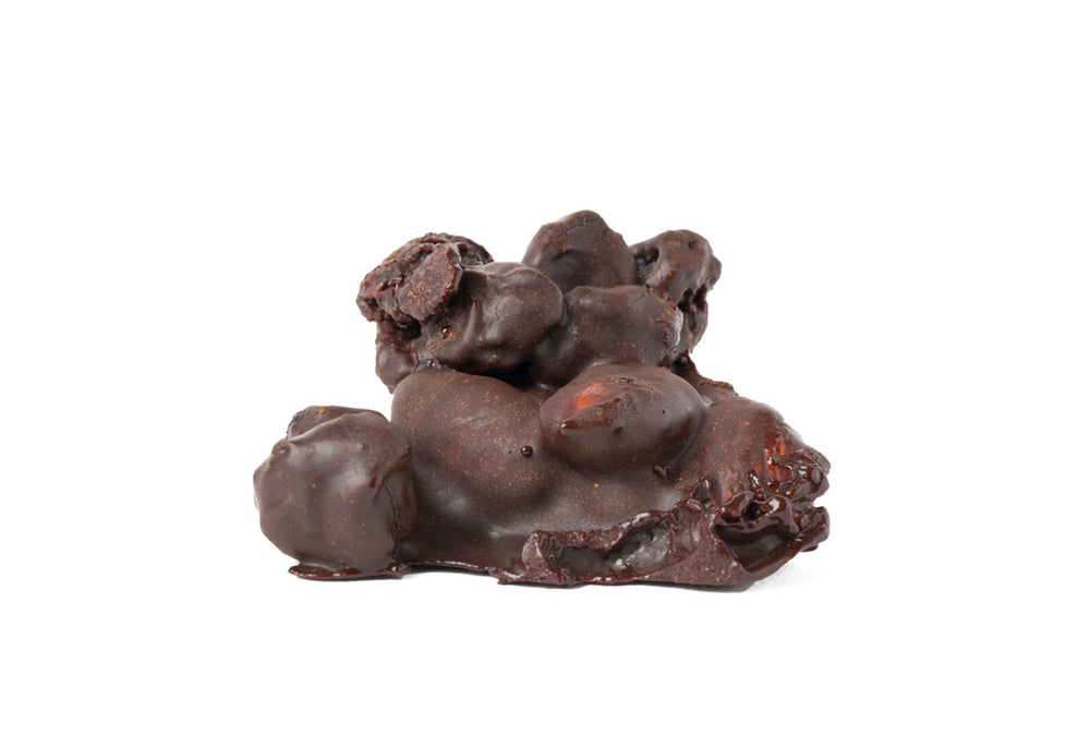 cluster of dried fruit, almonds, spices, covered in dark chocolate on white background
