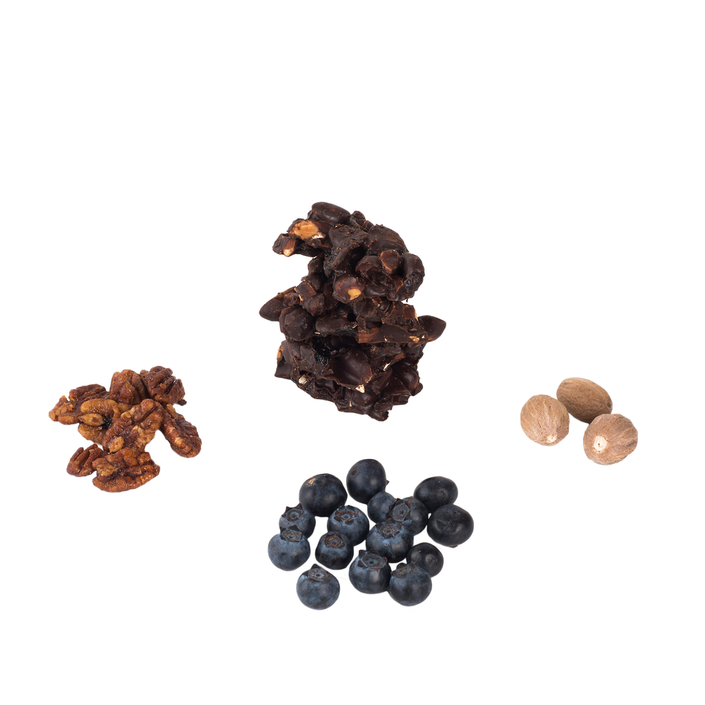 Cluster of blueberry, cluster of pecans, cluster of nutmeg, and cluster of chocolate superfood snack