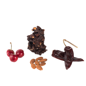 Cherries, raw almonds, Chile peppers, and cluster of chocolate superfood snack