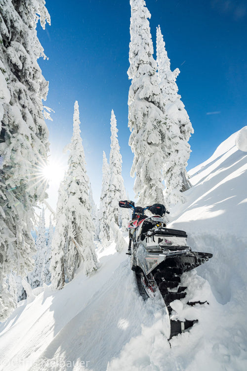 Yeti Snowmx Snowbike in fresh snow with C3 Powersports thermostat footpegs handguards handlebars and accessories