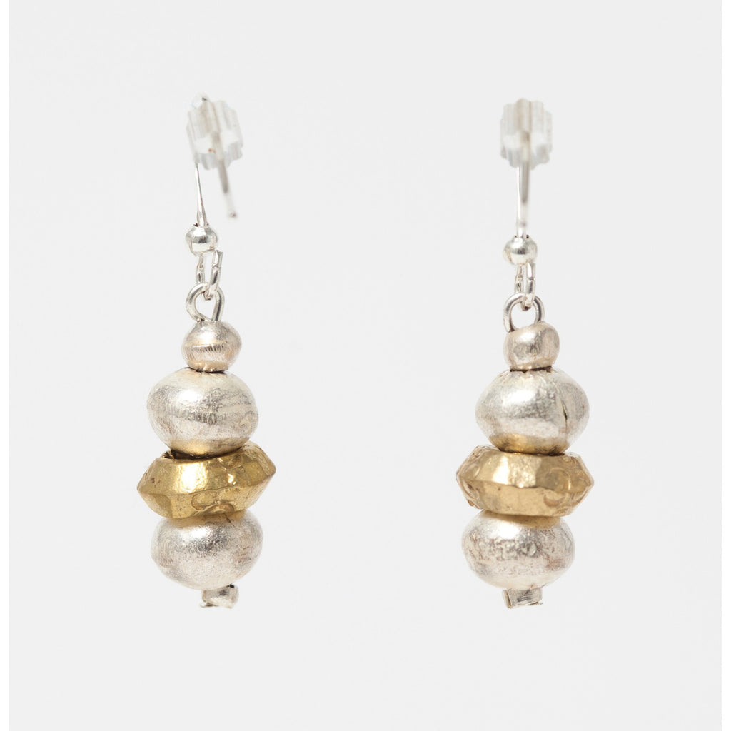Silver and brass earrings made with recycled bullet shell casings and recycled amulets