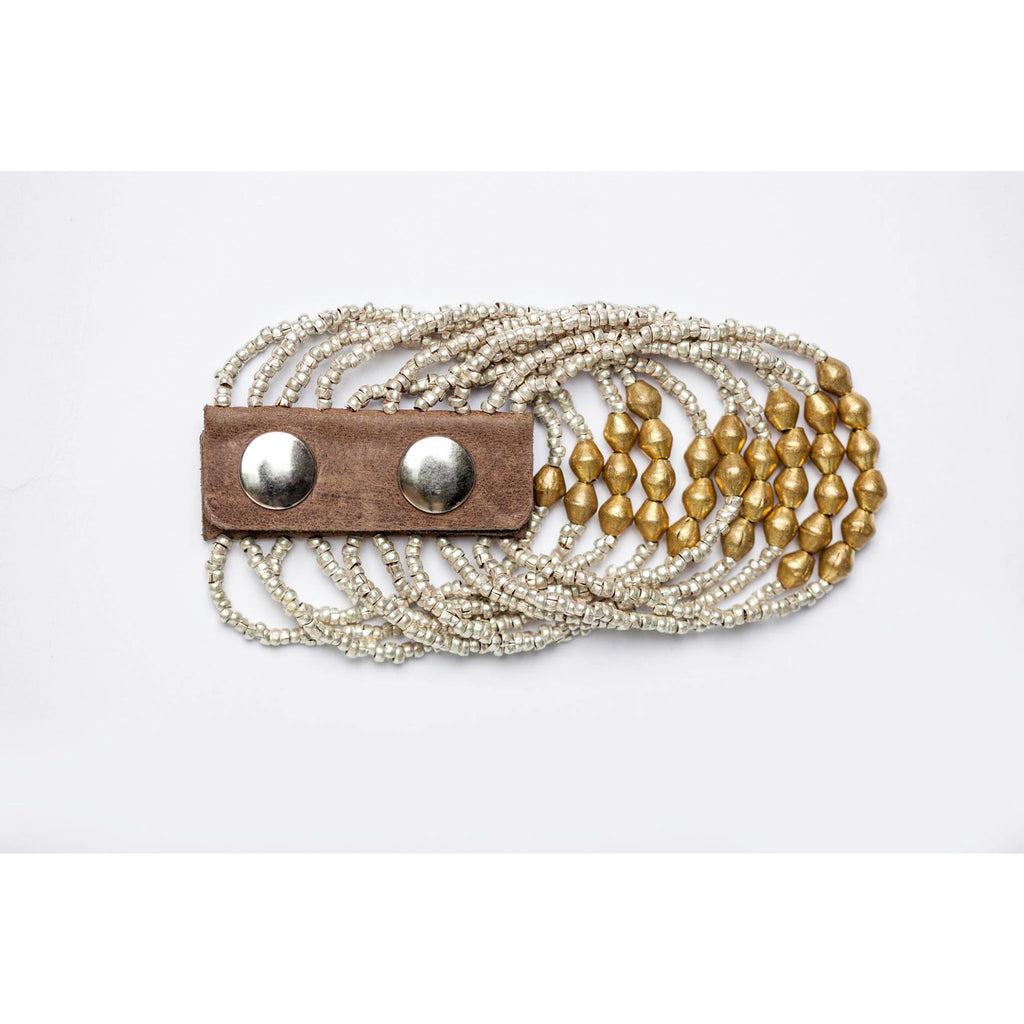 Bracelet made of recycled silver and brass balls and old amulet with leather strap