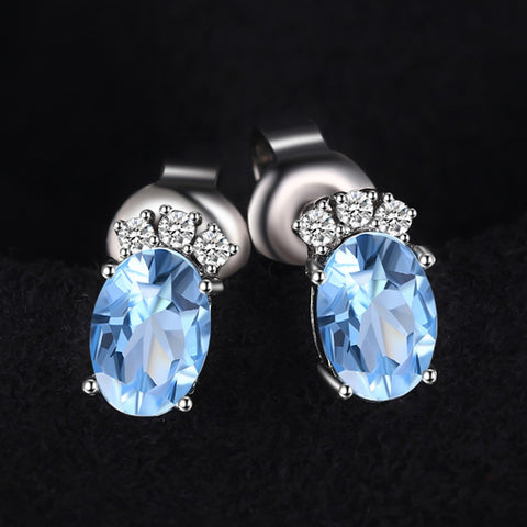 Image of Classy Oval Cut Sky Blue Topaz Stud Earrings