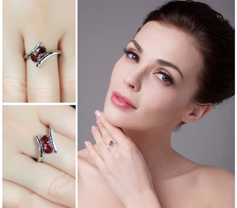 The Twins (ring) in Garnet