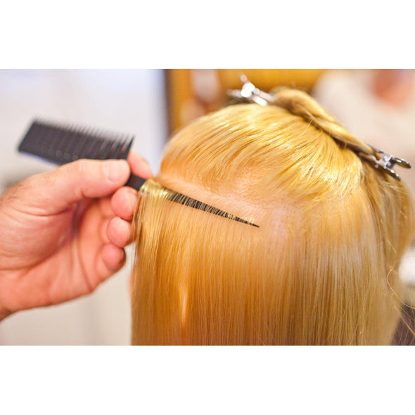 Person demonstrating step #1 in using the Highlighting and foiling comb to easily color hair