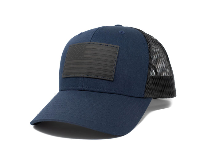 Dark blue trucker hat with black leather American flag patch