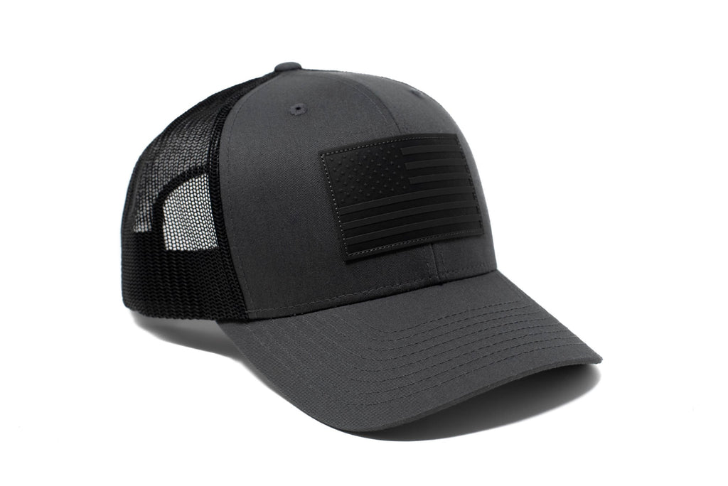 Charcoal trucker hat with black leather American flag patch