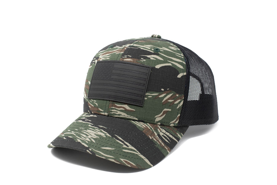 Tiger stripe trucker hat with black leather American flag patch