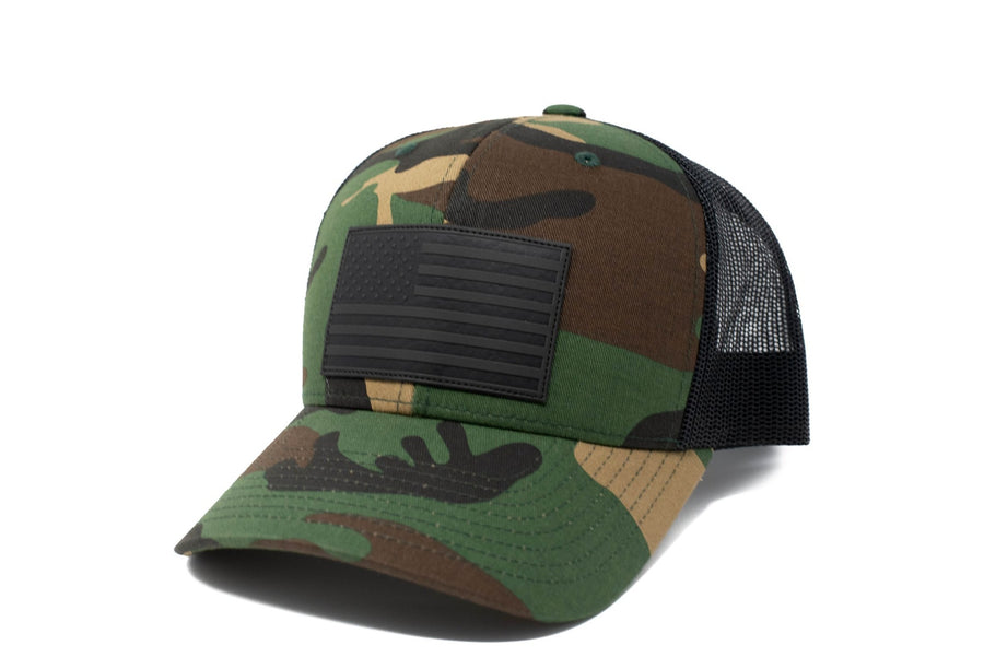Woodland Camo trucker hat with black leather American flag patch