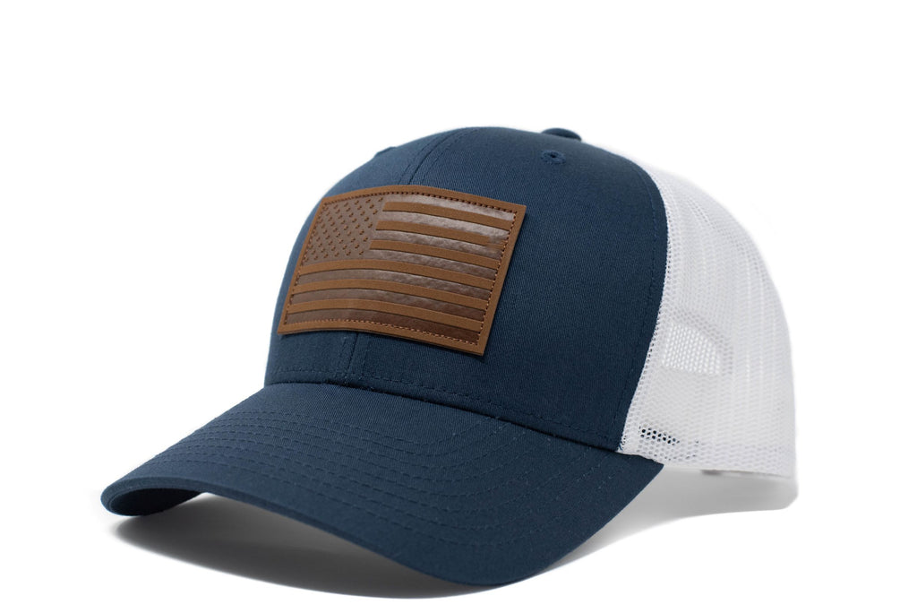 Navy trucker hat with brown leather American flag patch