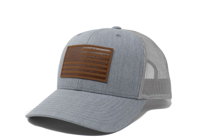 Grey trucker hat with brown leather American flag patch
