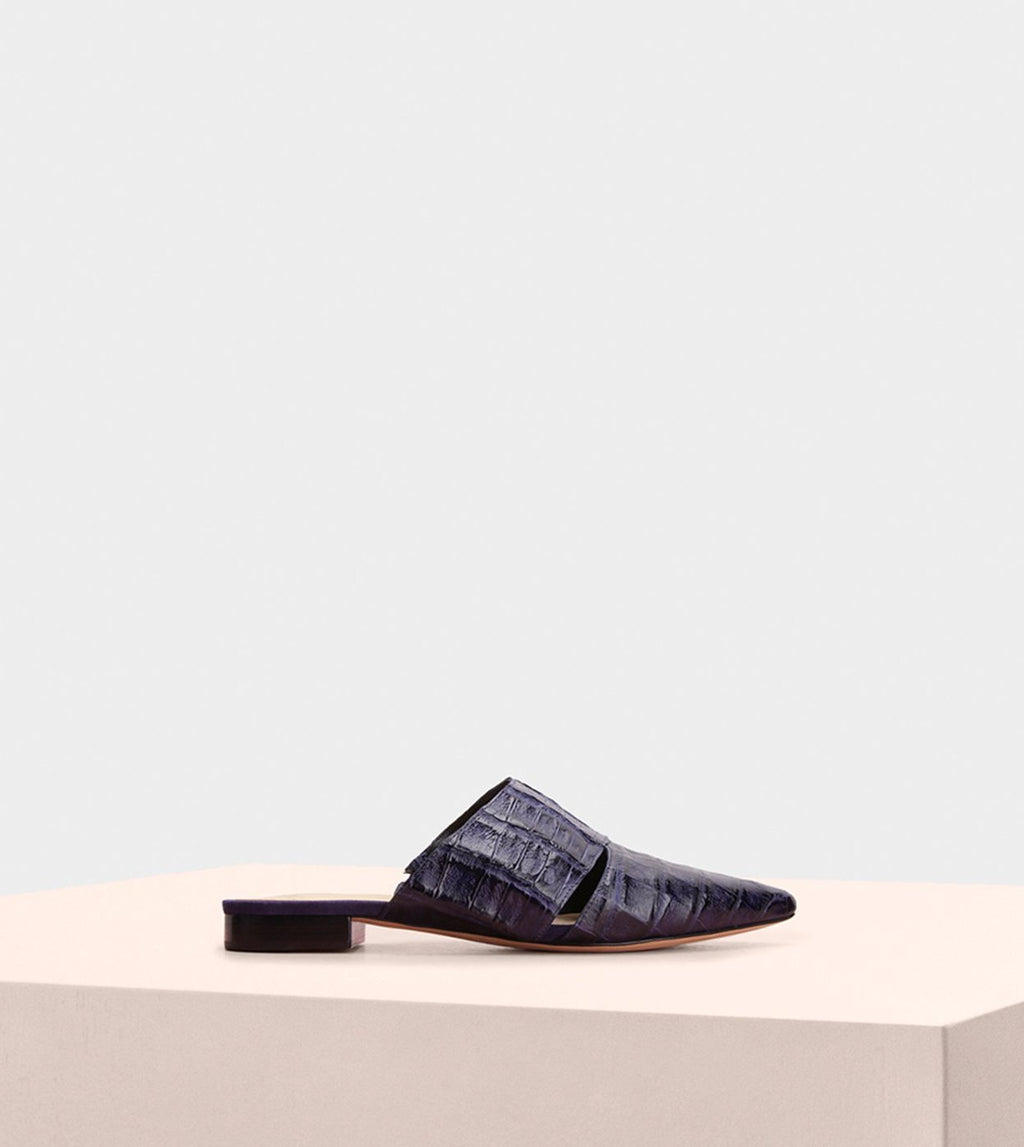 AURA FLAT MULE IN PURPLE CROCODILE