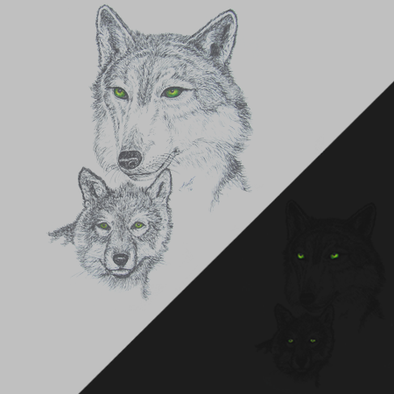 Detail of Green Eyed Wolf wildlife t-shirt design, featuring a mama wolf and her cub, both with glow in the dark eyes
