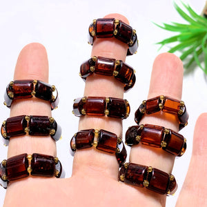 One Genuine Cherry Baltic Amber Ring on Stretchy Cord (Adjustable- Size 7-11) - Earth Family Crystals