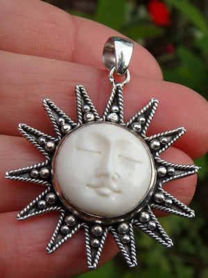 Sleeping Sun Bone Face Pendant in Sterling Silver (Includes Silver Chain)