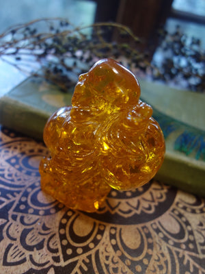 Vibrant Reconstituted Amber Buddha Carving - Earth Family Crystals