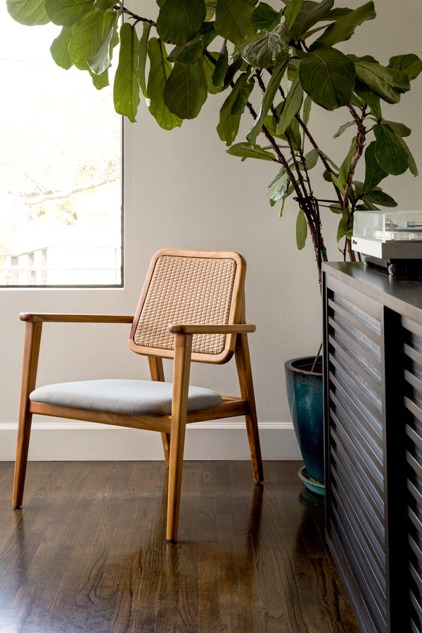 Mid Century Modern Dining Chair. Solid teak wood frame, woven rattan backrest, and grey cushion.