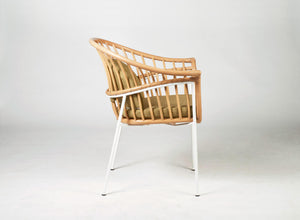 Unique designer dining chair Made of natural rattan bound with paper loom and metal frame. Green cushion.