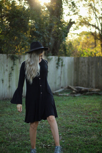 Ruffle some feathers dress in black