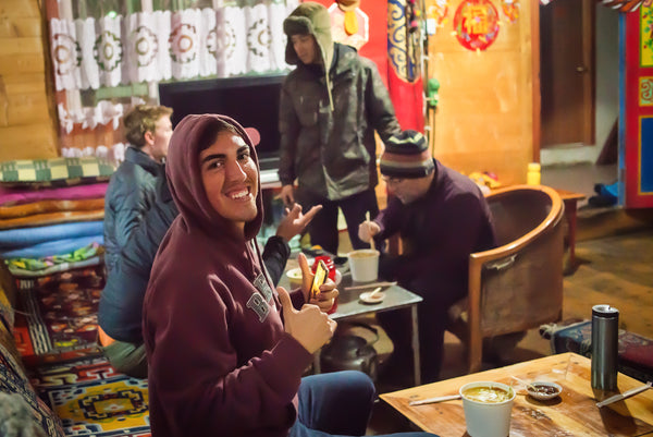 Foreign travelers share a meal at a Tibetan hostel
