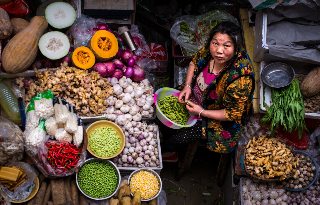 Tibetan woman selling vegetables in Kangding fresh market