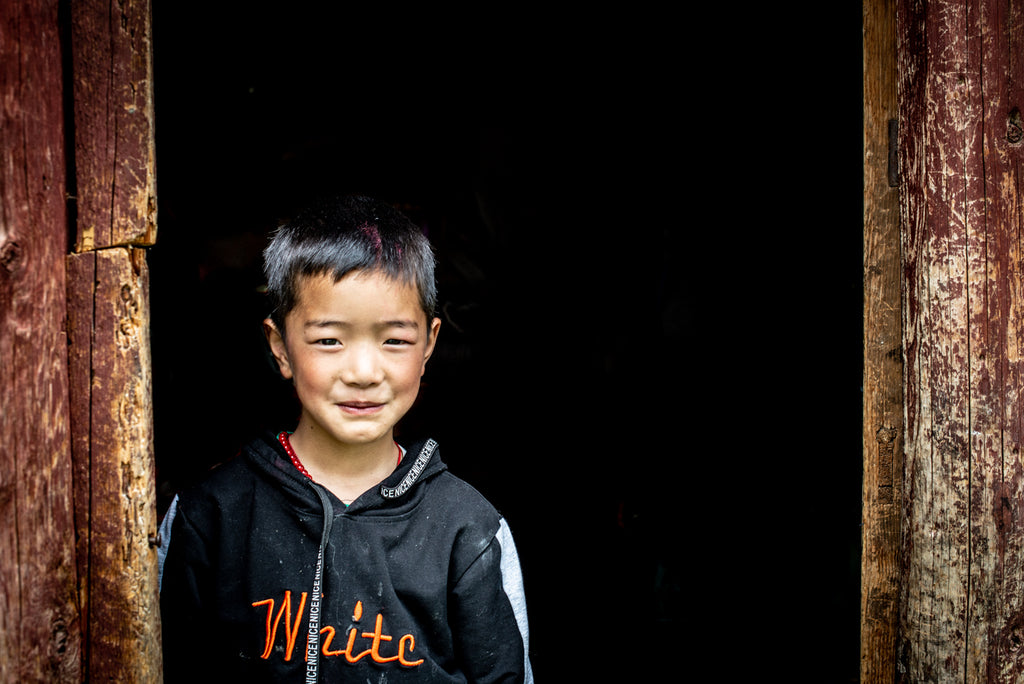 Tibetan boy out of the shadows