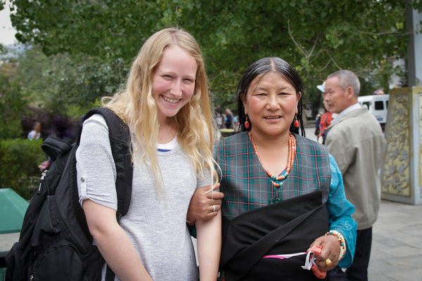 single female traveler with Tibetan woman