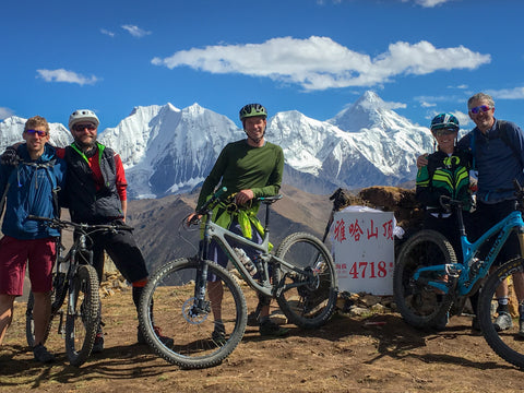 Mountain Bike Riders stop for a photo beside an elevation marker at 4718 ft.