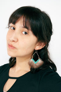modern statement earrings with bright blue