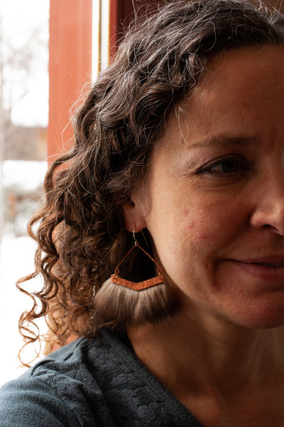 Yes, you can wear statement earrings with curly hair