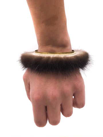 Sea otter fur cuff with exposed brass