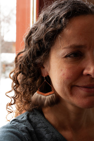 how to wear bold statement earrings with curly hair