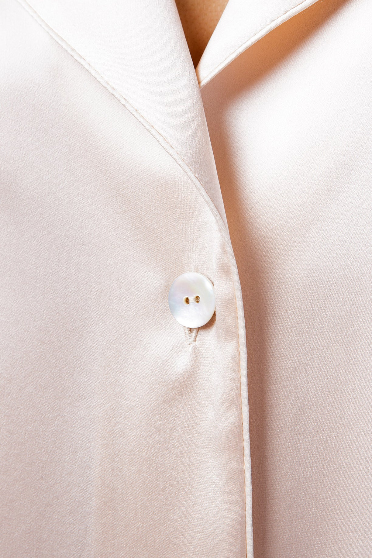 Ann shirt in blush, button closeup