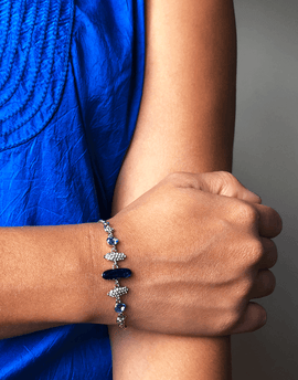 Oflara Round Blue Crystal Bracelet (Real Look)