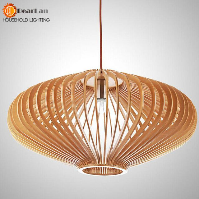 Elegantly cut wooden pendant in 3 sizes