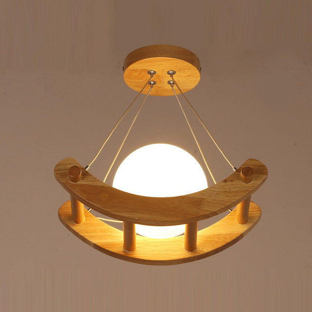 Wooden boat with glass moon pendant light