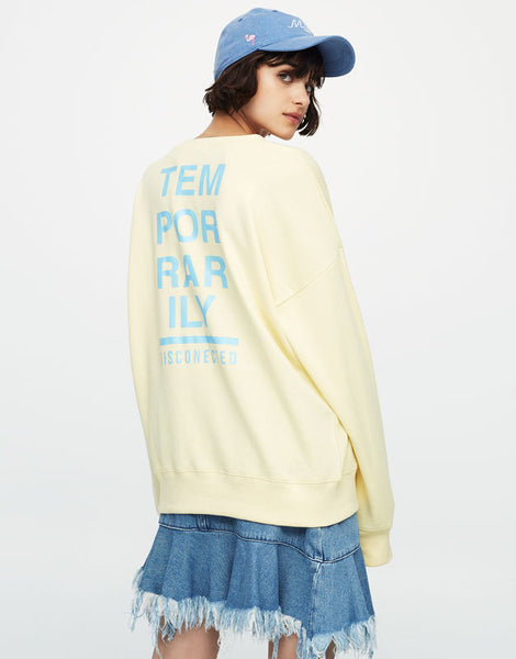 Sweatshirt with slogan on back