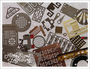 A selection of etched metal items - apex signs and engraving