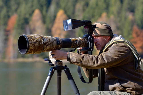 wildlife photography photographer with telephoto lens