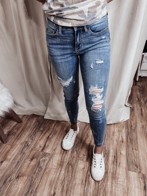 JB skinny destroyed mid-rise jeans