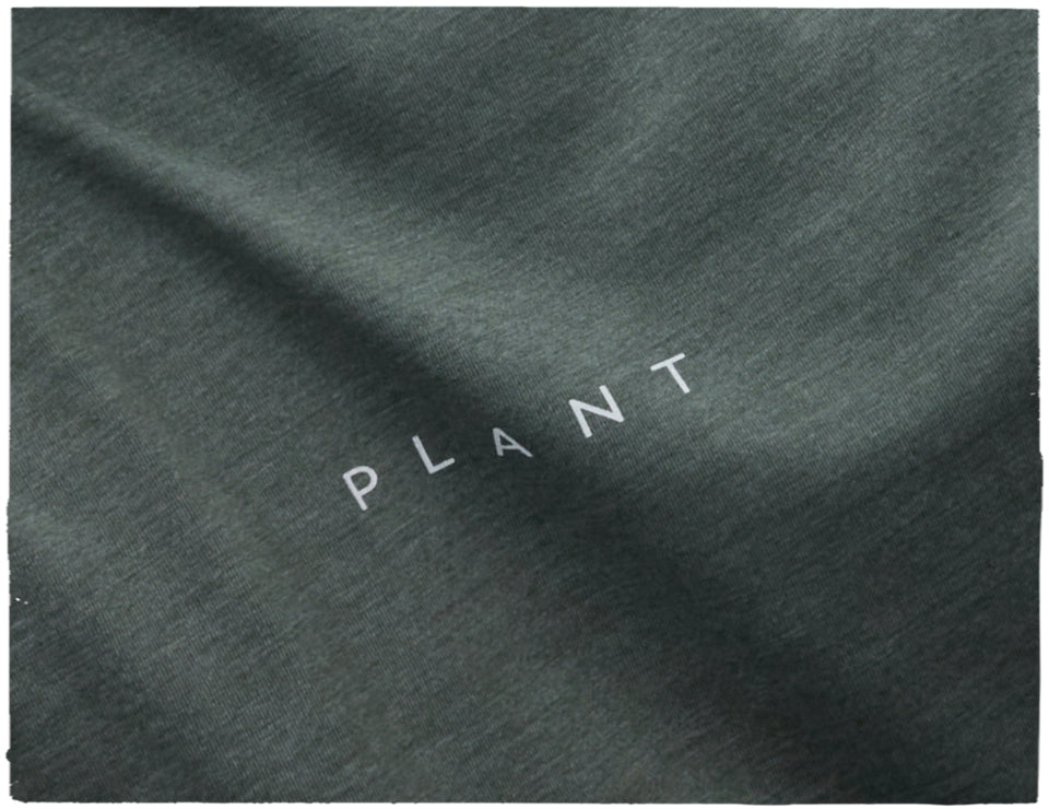 An upclose shot of a PLANT collection t-shirt.