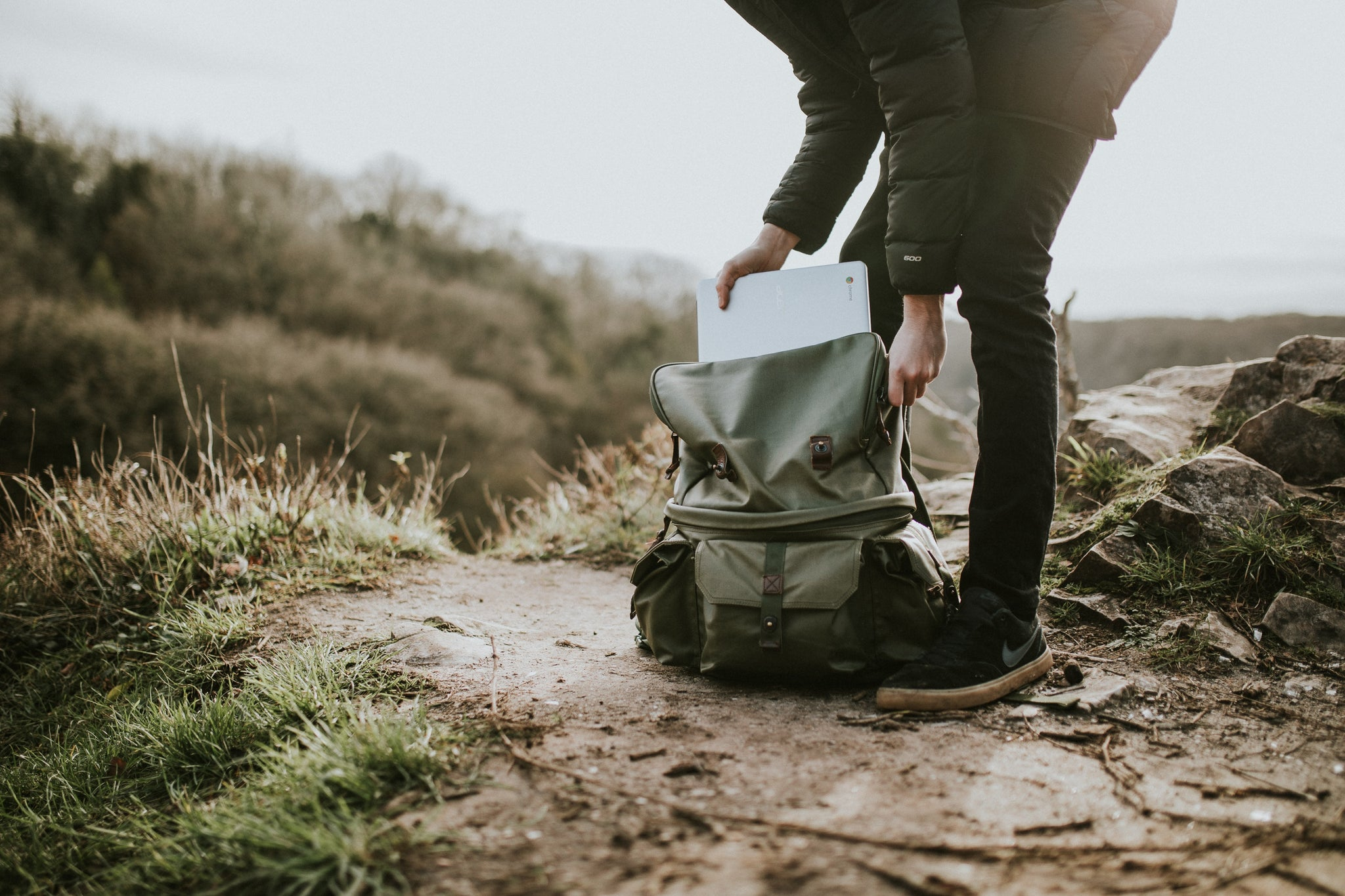 person hiking computer bag