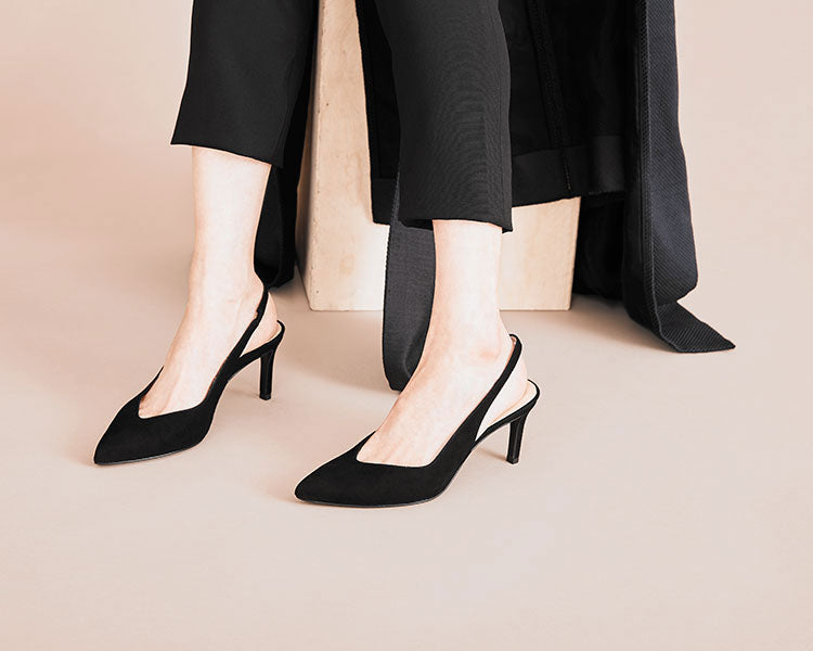 Model wearing Mia slingback heel in black suede