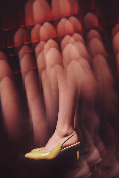 Kaleidoscope view of model's foot wearing Inez Mia slingback in almond nappa.